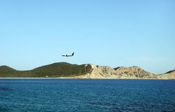 Airplane over Mediterranean Sea. Airplane preparing for landing in Ibiza Island, Spain royalty free stock photography