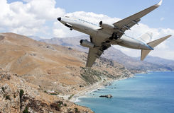 Airplane over mountains Stock Photography