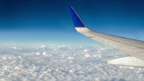 Airplane over Moving Clouds stock video