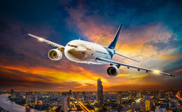 Airplane over night scene city Royalty Free Stock Photos