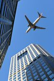 airplane over office building stock images