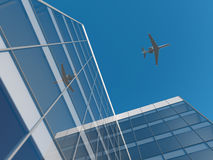 Airplane over office building Royalty Free Stock Photography