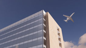 Airplane over office building Royalty Free Stock Images