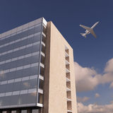 Airplane over office building. Airplane flying over office building Royalty Free Stock Photography