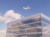 Airplane over office building. Airplane flying over office building Stock Photos