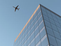 Airplane over office building. Airplane flying over office building Stock Photography