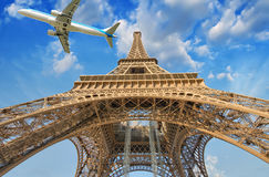 Airplane over Paris, France. Tourism and vacation concept Stock Image