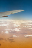 Airplane over Sahara desert Stock Photography