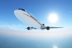 Airplane over sea Stock Images
