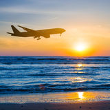 Airplane over a sea coast Royalty Free Stock Image