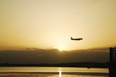 Airplane over Tunis Lake at sunset Stock Photo
