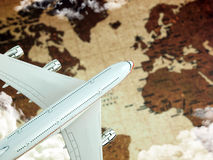 Airplane over world map Royalty Free Stock Image