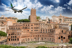 Airplane overflying Imperial Forums in Rome Royalty Free Stock Photos