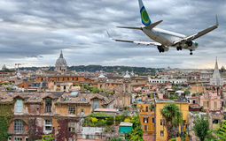 Airplane overflying Rome skyline Stock Photo
