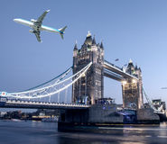 Airplane overflying Tower Bridge in London Royalty Free Stock Photography