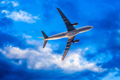 Airplane overhead flying Royalty Free Stock Photography