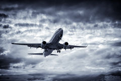 Airplane overhead flying Royalty Free Stock Image