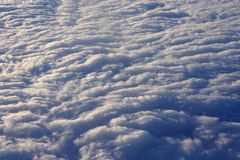 Airplane panorama. Higher than the sky - soft clouds Royalty Free Stock Image