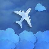 Airplane with paper clouds on a blue air background Stock Photo