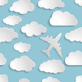 Airplane with paper clouds on a blue air Seamless  pattern Stock Photos