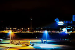Airplane park at airport at night Stock Photos