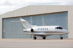 Airplane parked. In front of hangar Royalty Free Stock Photo