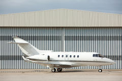 Airplane parked. In front of hangar Stock Photography