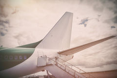 Airplane parked against cloudy sky Royalty Free Stock Image