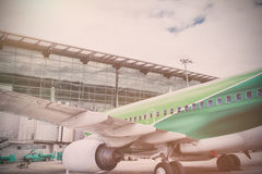Airplane parked by airport Royalty Free Stock Photo