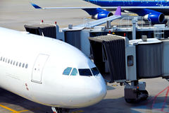 Airplane parked at the airport Royalty Free Stock Images