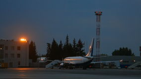 Airplane parked at early morning stock video footage