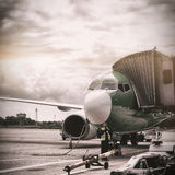 Airplane parked on runway Stock Photos