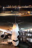 Airplane parking at Tokyo international airport Royalty Free Stock Photo