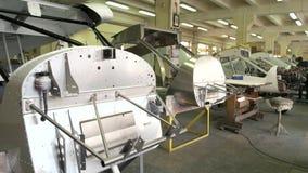 Airplane parts in workshop.