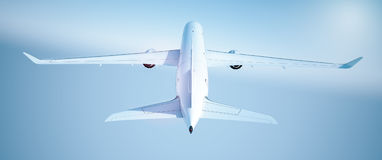 Airplane. Passenger airplane Airbus A360 800 over blue sky, back view Stock Image