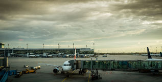 Airplane with passenger boarding bridge at airport gate Royalty Free Stock Image