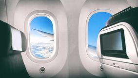 Free Airplane Passenger Seat Plane Interior With Window View Of Flying Aircraft Wing And Movie Screen Stock Photography - 156885602