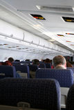 Airplane Passengers. Passengers sit on an airplane Royalty Free Stock Image