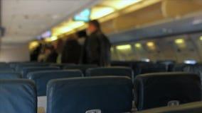 Airplane Passengers Disembarking Tilt Shift stock footage