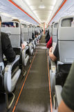 Airplane with passengers on seats waiting to take off Stock Photo