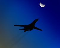 Airplane passing the moon Royalty Free Stock Photography