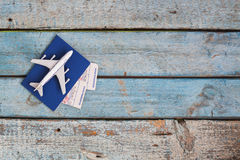 Airplane on a passport with air tickets, close-up, on a wooden b. Ackground Royalty Free Stock Photos