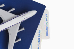 Airplane on passport with air tickets, isolated on white backgro. Und, close-up Royalty Free Stock Photography
