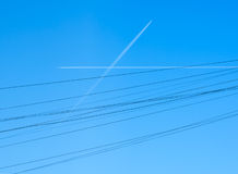 Airplane paths crossed in the sky. Like wires Royalty Free Stock Images