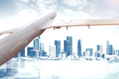 Airplane and peeking city. White airplane and cityscape peeking through clouds. 3D Rendering Stock Photography