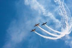 Airplane perform aerobatic Stock Photos