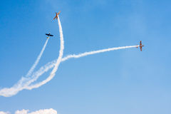 Airplane perform aerobatic Royalty Free Stock Photo