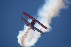 Airplane performig in airshow Royalty Free Stock Photos
