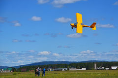Airplane performing a demonstration low over the ground. There is a video of the plane during a speech Stock Photo