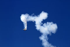 Airplane performing stunt during air show Stock Images